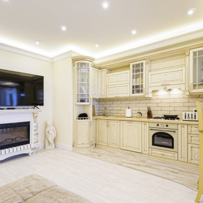 white kitchen with fireplace